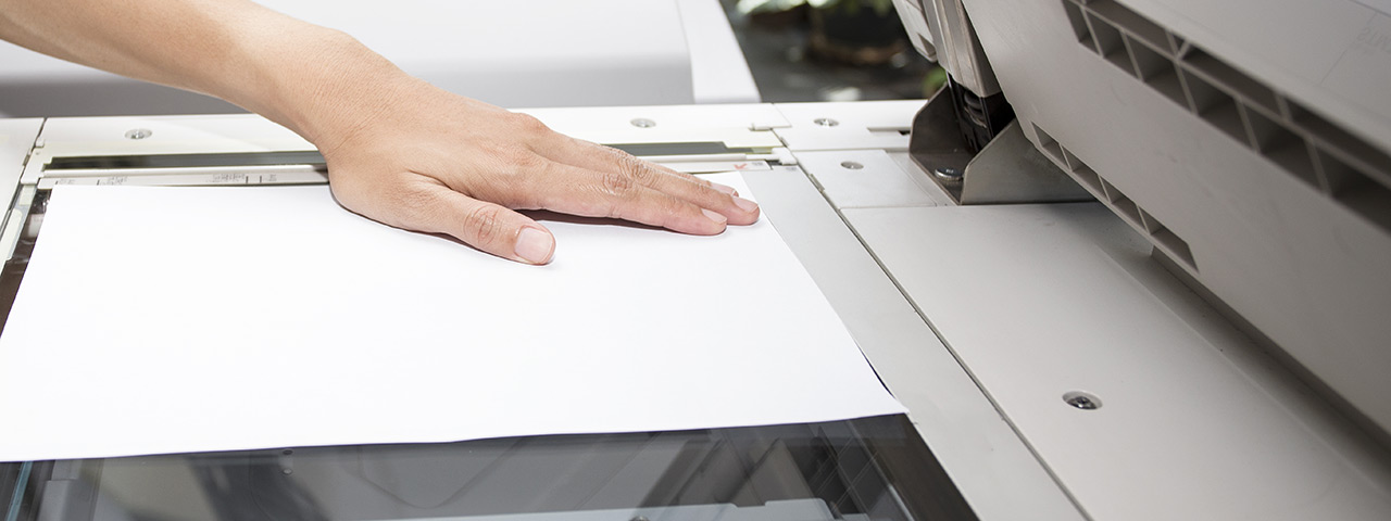 woman's hand scanning a document